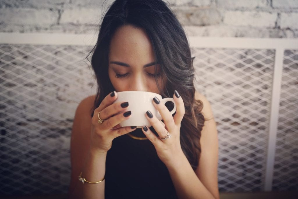 woman drinking chaga